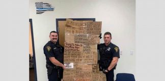 police-officers-gift-their-supervisor-cardboard-signs-which-were-taken-from-homeless-people
